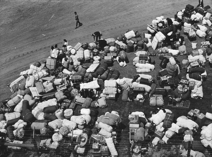 Los Angeles (vicinity), California. Baggage of Japanese-Americans evacuated from certain West coast areas under United States Army war emergency order, who have arrived at a reception center at a racetrack.