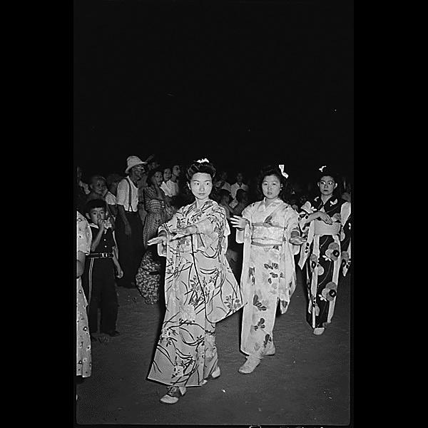 Granada Relocation Center, Amache, Colorado. Participants in the Bon Odori dance, August 14, sponsored by the Granada Buddhist Church, showing colorful kimonos.