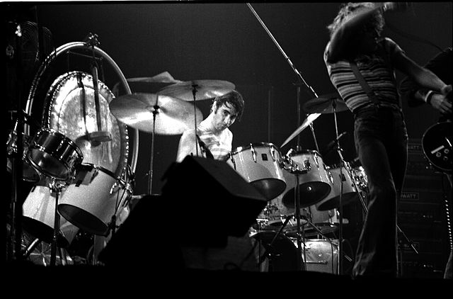 Keith Moon on drums. The WHO, MLG, Toronto, 21 October 1976. photo by Jean-Luc. Creative Commons License via Wikimedia Commons