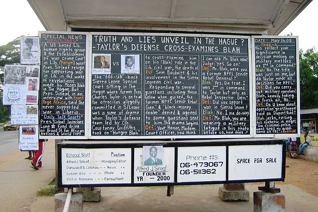 A daily news chalk board in Monrovia, Liberia. Photo by Lieutenant Colonel Terry VandenDolder, U.S. Africa Command. Public domain via Wikimedia Commons.
