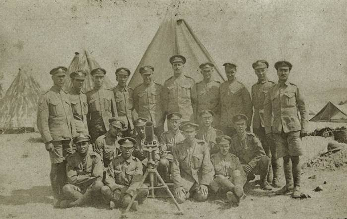 Stokes trench mortar with team. Group of soldiers posing with a trench mortar, Salonika, taken by Capt Philip Rolls Asprey, whilst serving with 2nd Bn The Buffs (East Kent Regiment), nd, 1916 © National Army Museum.