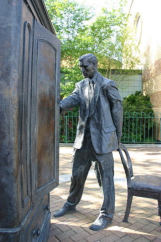 "Statue of C.S. Lewis looking into a wardrobe. Entitled ""The Searcher"" by Ross Wilson. Photo credit: ""Genvessel"",  Creative Commons via Flickr."