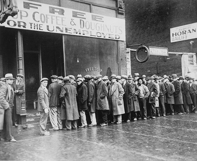 Unemployed men outside a soup kitchen, 1931, Public Domain via Wikimedia Commons.