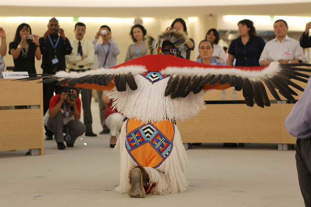 Apache Dancers at the Exhibit 'Dignity - Tribes in Transition'. United States Mission Geneva Photo: Eric Bridiers. CC-BY-ND-2.0 via US Mission Geneva Flickr.