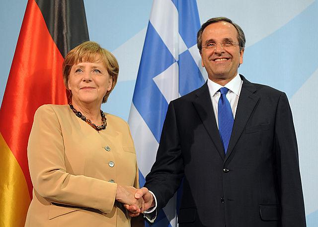 Angela Merkel - Αντώνης Σαμαράς, 2012. Photo by Αντώνης Σαμαράς Πρωθυπουργός της Ελλάδας. CC BY-SA 2.0 via Wikimedia Commons.