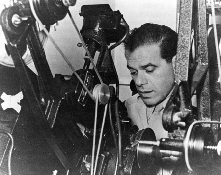 Frank Capra cuts Army film as a Signal Corps Reserve major during World War II, circa 1943. US Army. Public domain via Wikimedia Commons.