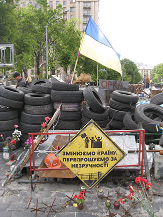 "A fake road sign used by the pro-European protesters in Kyiv: ""Changing the country, sorry for the inconvenience."""