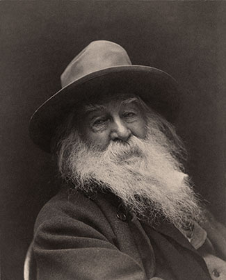 Walt Whitman by George C. Cox (1851–1903, photo) Adam Cuerden (1979-, restoration). Public domain via Wikimedia Commons.