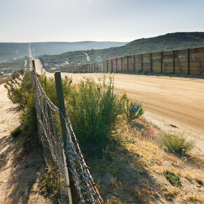 US/Mexico border fence near Campo, California, USA. © PatrickPoendl via iStockphoto.