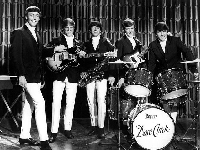 Publicity photo of The Dave Clark Five from their cameo performing appearance in the US film Get Yourself a College Girl. 27 November 1964. (c) MGM. Public domain via Wikimedia Commons