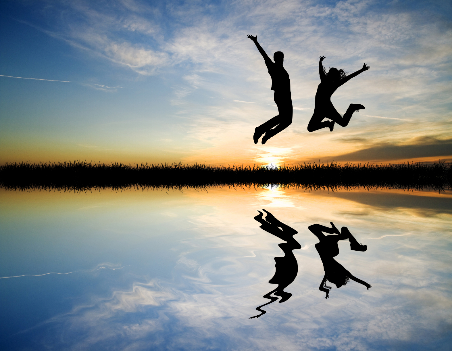 People jumping at sunset. © RossellaApostoli via iStock