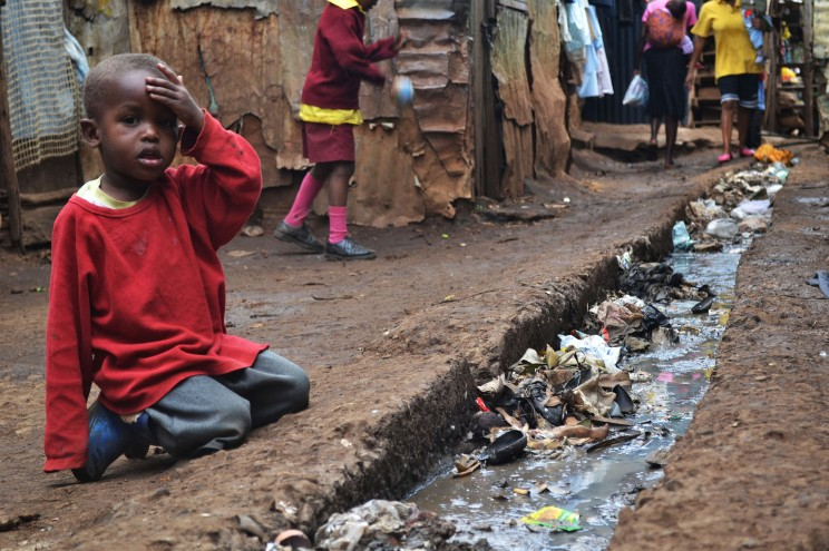 Young boy poverty slum