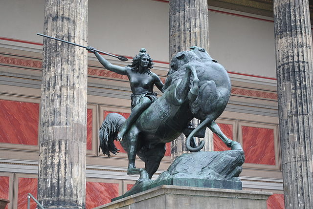 Statue of fighting Amazon outside Altes Museum Berlin. Photo by Christian Benseler. CC BY 2.0 via Wikimedia Commons.