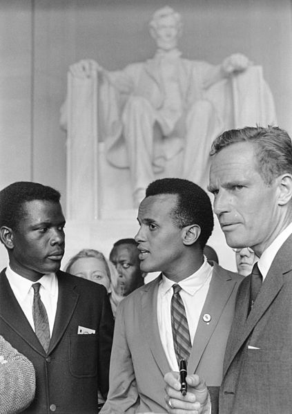 Sidney Poitier, Harry Belafonte, and Charlton Heston at the Lincoln Memorial during the Civil Rights March on Washington in August, 1963. National Archives and Records Administration, Public Domain via Wikimedia Commons.