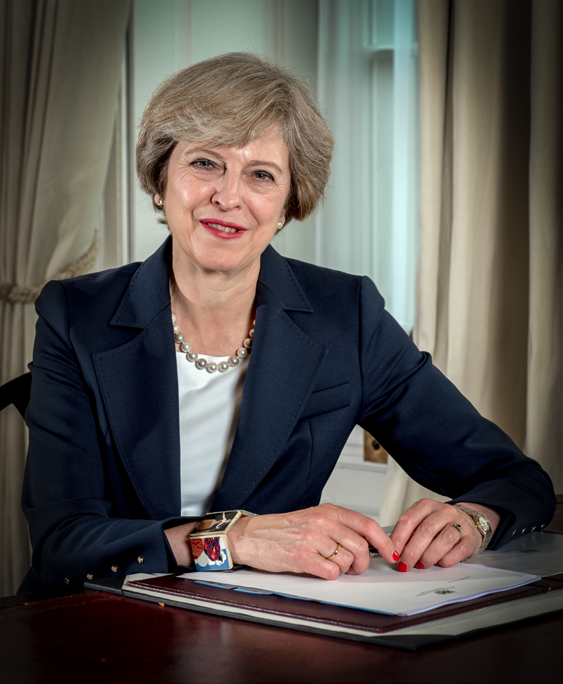 Portrait of British Prime Minister Theresa May by Controller of Her Majesty's Stationery Office. OGL v.3 via Wikimedia Commons.